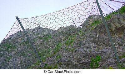 Wire mesh on the mountain rocks for rockfall protection