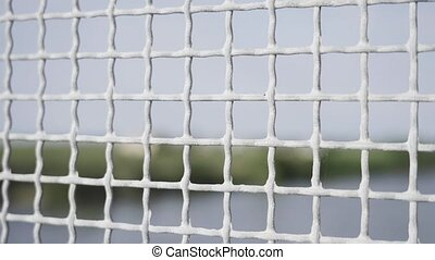 Wire mesh with small holes and blurred background