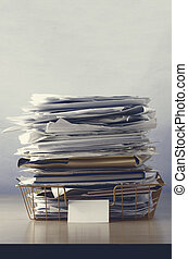 Wire Office Tray Piled Up with Papers - A wire office tray...
