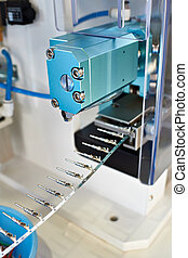 Wire stripping machine closeup. Technology concept