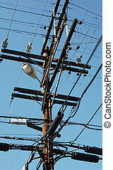 telephone pole with electrical, telephone, communication and lighting wiring
