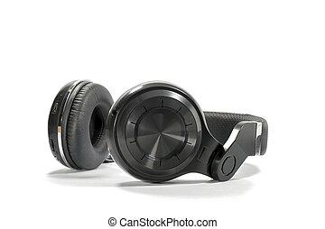 Wireless Bluetooth headphone or earphone isolated on white...