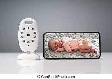 Wireless Camera And Smartphone On Reflective Table