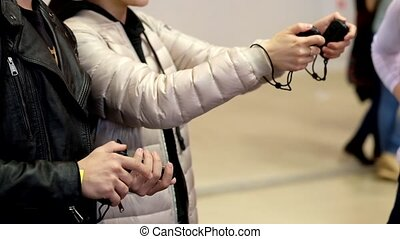 gamepads in the hands of gamers