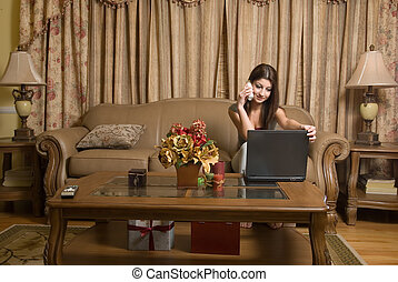 Wireless technology - Attractive woman sitting on the sofa...