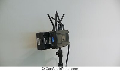Wireless transmitter technology camera movement closeup