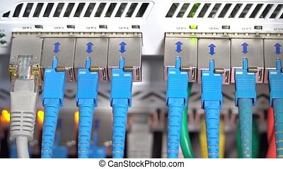 Wires in a router, close-up - Router with flashing lights...