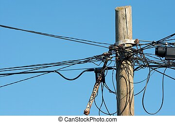 Wires - Lots of messy wires on a wooden pillar