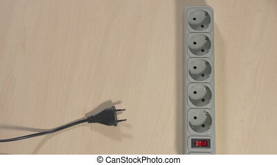 Wires pluged in power strip - Multiple wires plugged in grey...