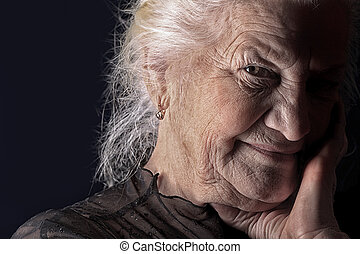 wisdom - Portrait of a happy senior woman smiling at the ...
