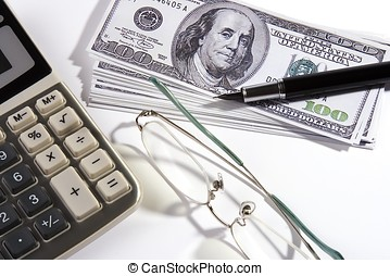 Wise Investment - Close up shoot of calculator, US Dollar,...