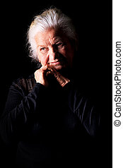 wise old age - Portrait of a calm senior woman looking at ...