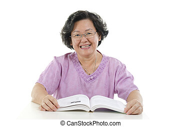 Wise Senior adult woman reading book