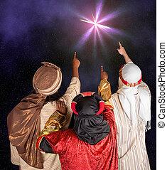 Wisemen Caspar Melchior and Balthasar following the star of Bethlehem