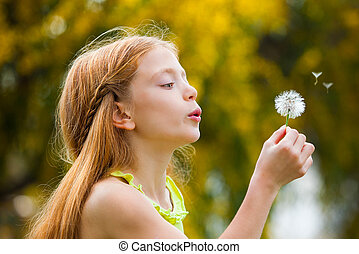 wishes child blowing dandelion,