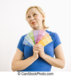 Wishful woman with paint swatches.