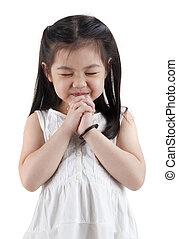 Wishing - Little girl wishing on white background