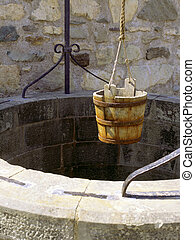 Wishing well - A water well with an old bucket in Fort...