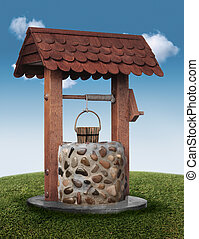 wishing well - Wishing well on grassy hill with blue sky