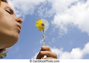 Wishing... - Woman wishing. Dandelion