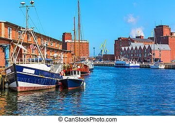 Scenic summer outdoor view of the Old Port pier town architecture with ships and boats in Wismar, Mecklenburg region, Germany