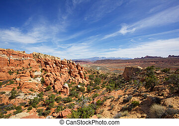 Wispy skys over Brown rocks - Arches Park near hells kitchen...