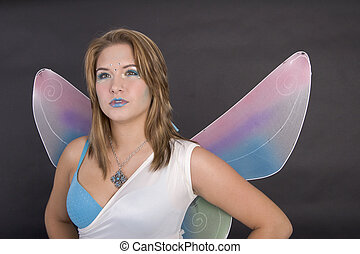 Pretty young woman dressed as fairy
