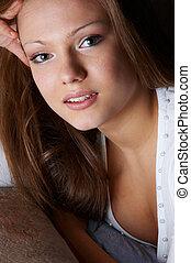 wistful glance of quiet pretty woman. facial closeup.