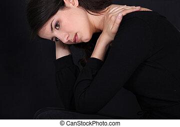 Wistful woman in black