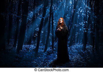 Witch at night forest
