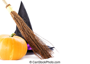 Witch broomstick, pumpkin and hat over white