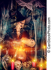 witch casts a spell - Attractive witch conjures in the ...
