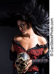 Witch craft - Beautiful latino woman holding her skull with...