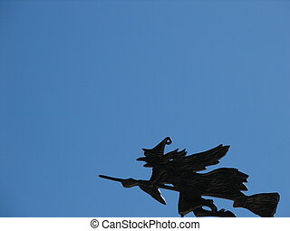 witch flying over the houses