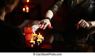Witch - fortune teller reading fortune. palmistry