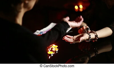 Witch - fortune teller reading fortune. woman engaged in magic. palmistry