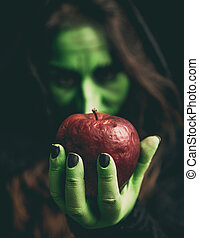 Witch hand with apple