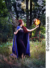 witch holding a fireball
