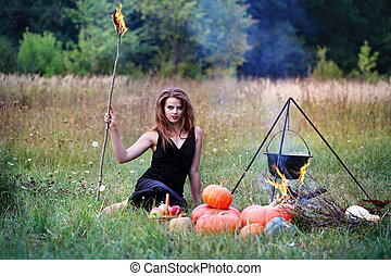 Witch holding torches