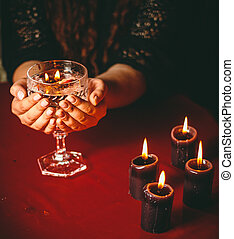 witch holds candle divination