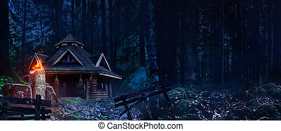 Witch house in woods.