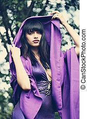 witch in a purple cloak