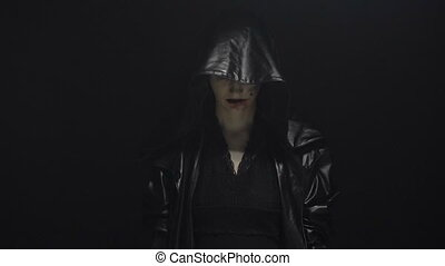 Witch in leather black hood - Footage of woman during ritual...