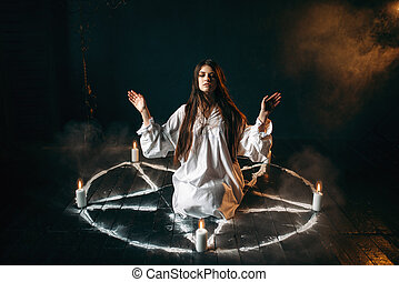 Witch in pentagram circle, evocation of spirits