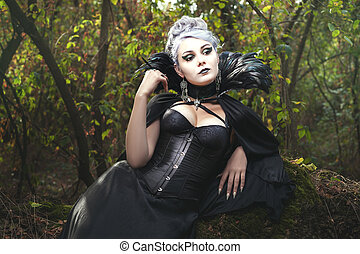 Witch in the woods. - Beautiful woman a witch in the dark...