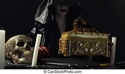 Witch opening the box - Footage of woman during ritual on...