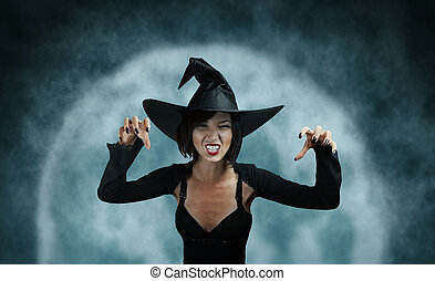 Witch performs magic - Scary witch performs magic on full...