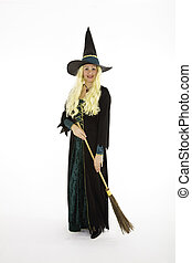 Witch - Caucasian woman dressed as a scary witch standing on...