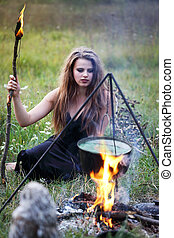 witch sitting at the potion
