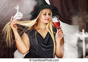 witch with a glass of blood